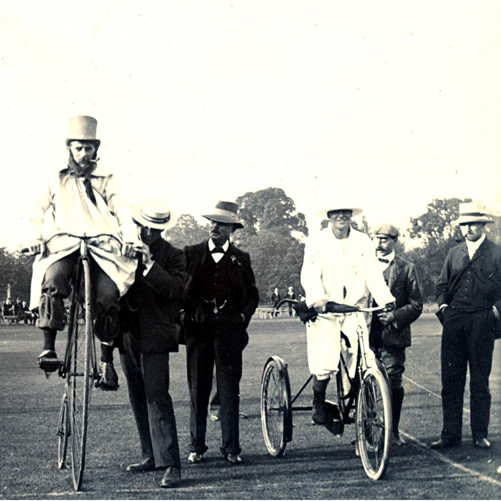 Black and white photos of men standing in suits with two men on high bicycles