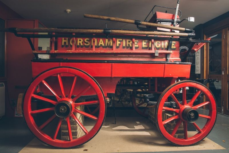A Victorian fire engine with Horsham Fire Engine written on the side