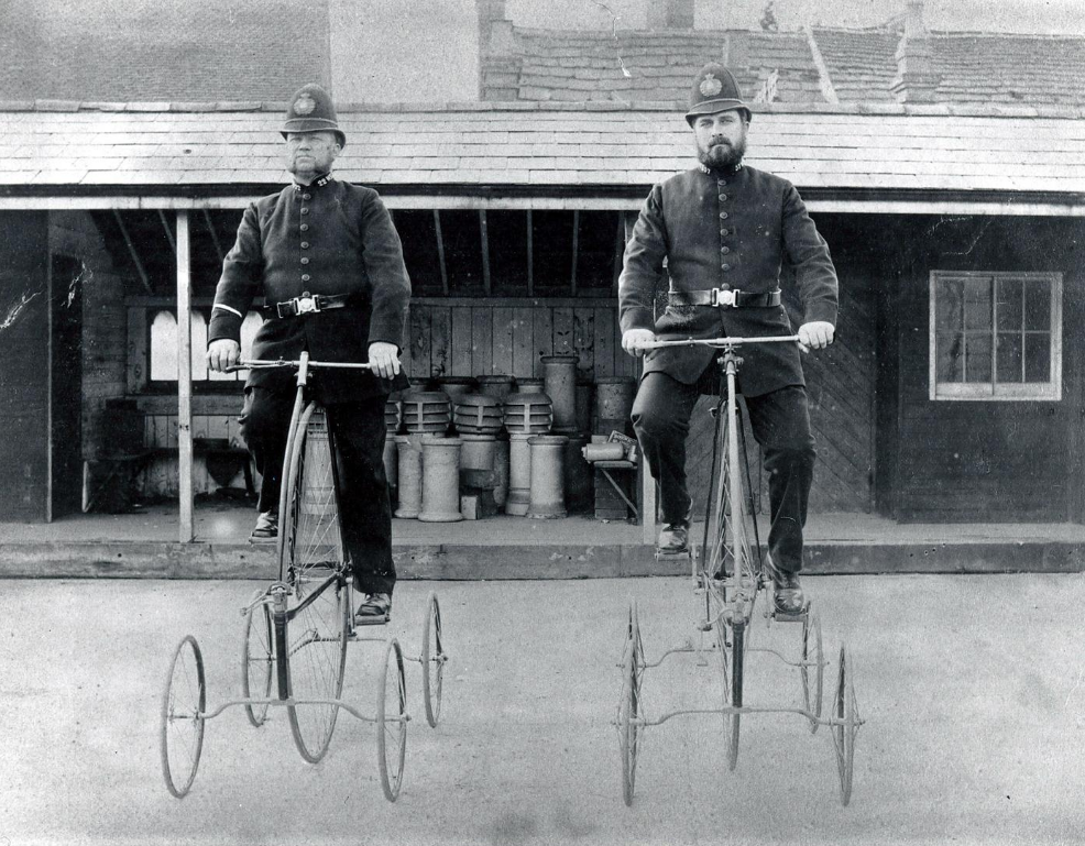 Two police officers on large bicycles