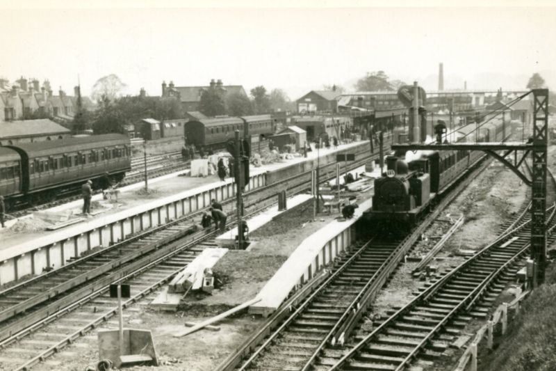 A black and white photo of the electrified railway tracks at Horsham