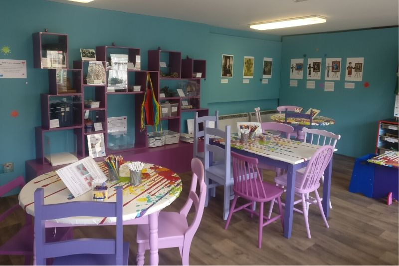 Tables set up in the Children's Art Zone