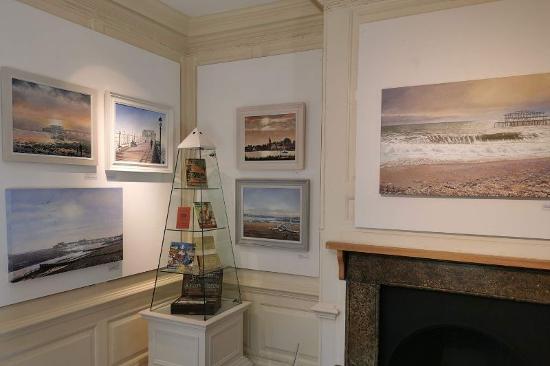 A corner of the Watercolour Gallery displaying beach scene watercolours