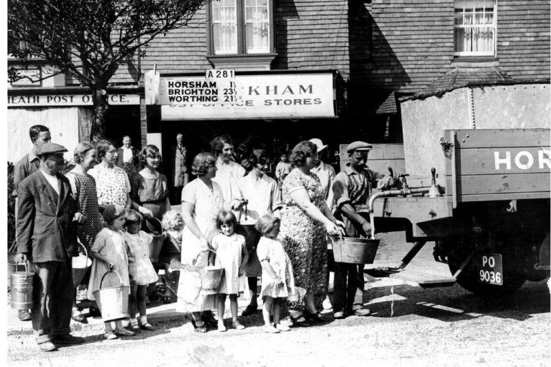 Water cart & queue outside Broadbridge Heath Post Office in 1934.