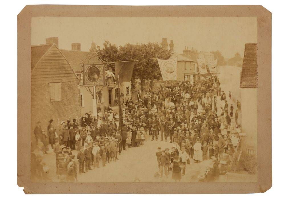 Photograph of a crowd of people outside a pub