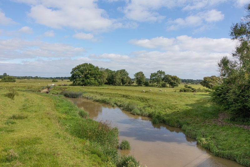 A view of the river and green fields at Henfield