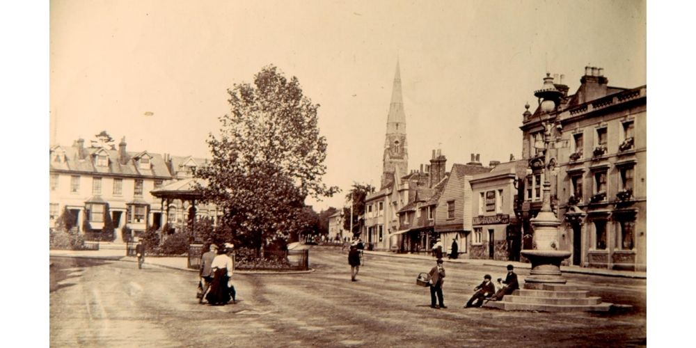 Sepia postcard of the Carfax, Horsham.
