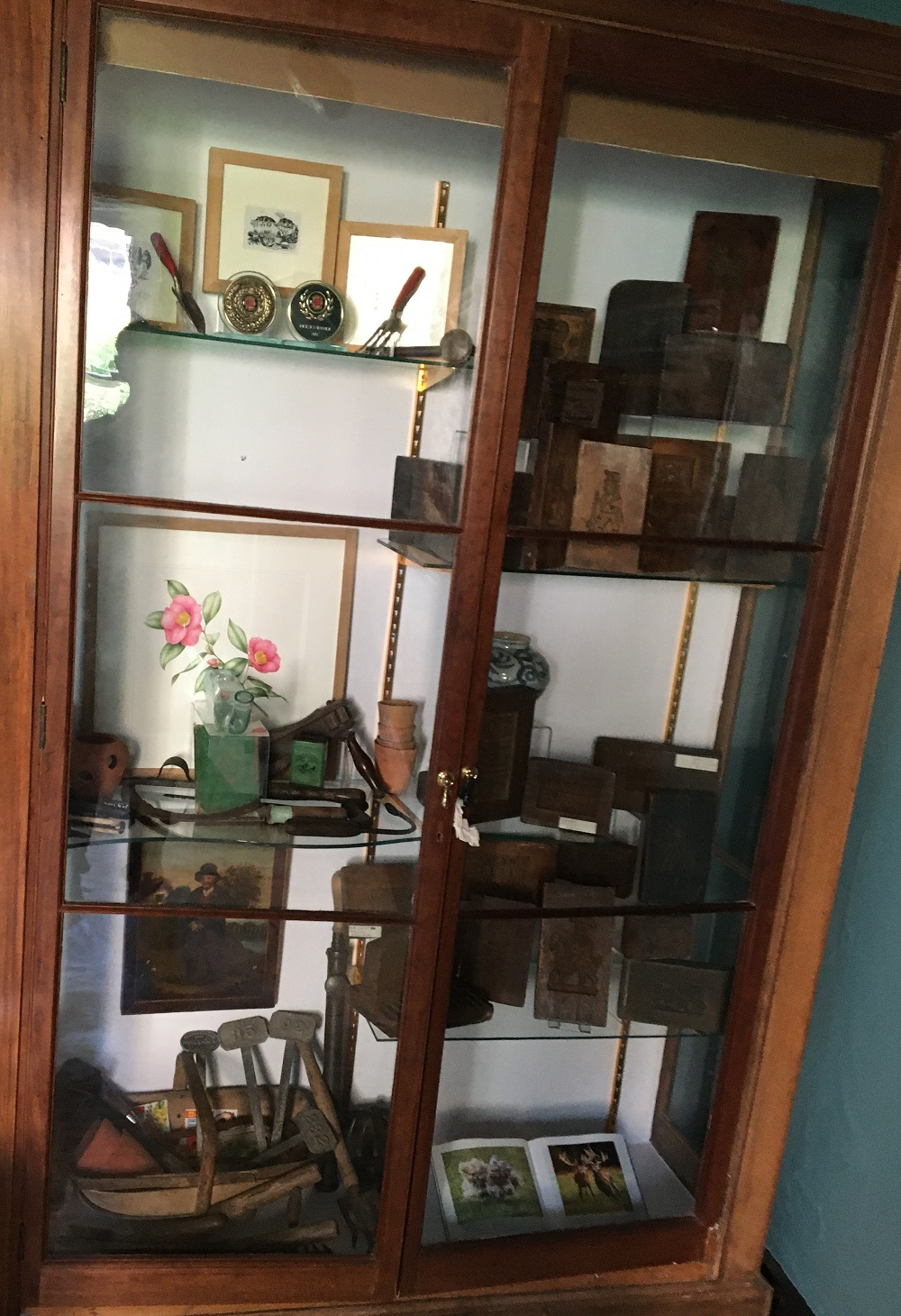 A cabinet displaying garden pieces