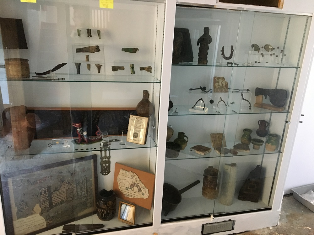 Saxon jewellery is displayed in a white and glass cabinet