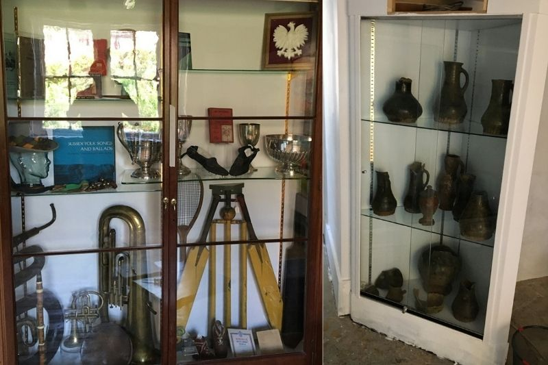 Two cabinets displaying a rich variety of artefacts