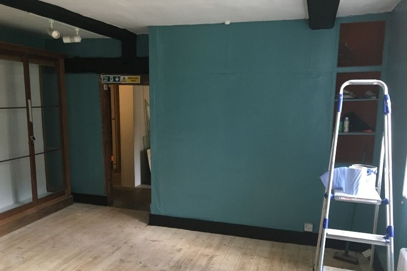 The Discover the District gallery has been painted in a fresh modern sea blue, a modern take on a heritage colour that complements the original beams and the pale wood flooring