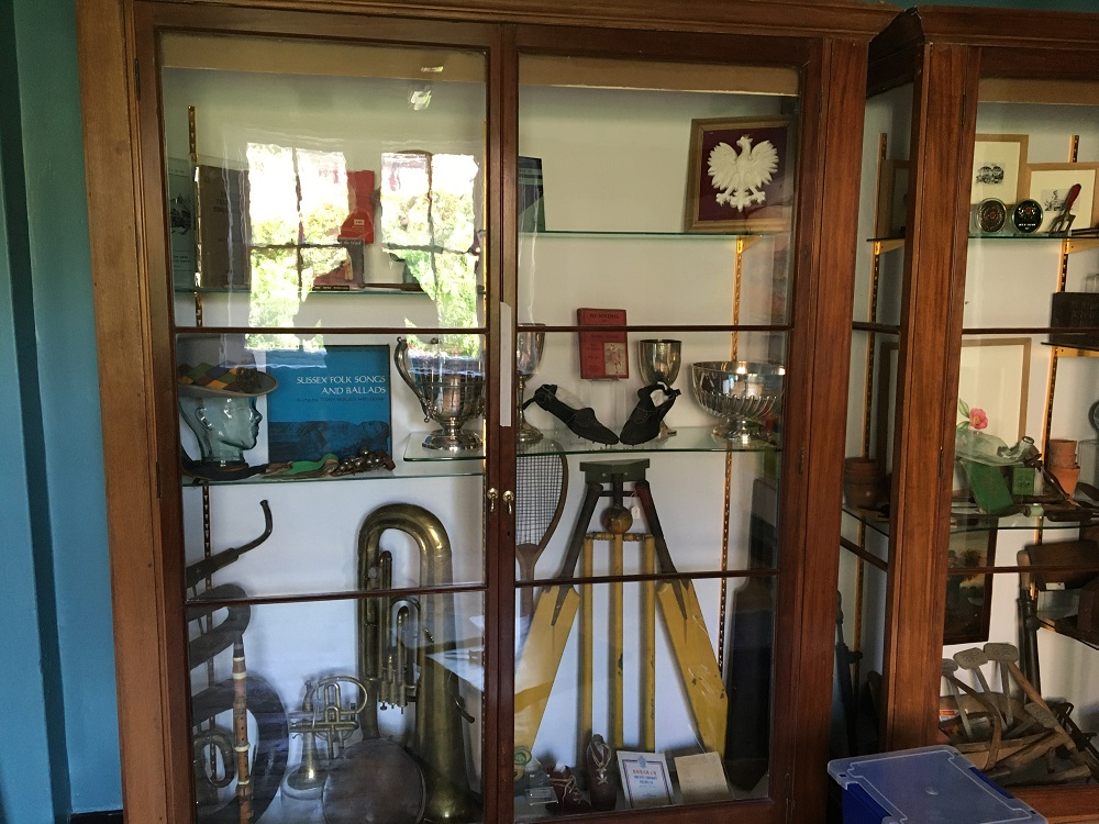 The grand 1920s ex V&A display cases have been repurposed to display part of the districts rich culture