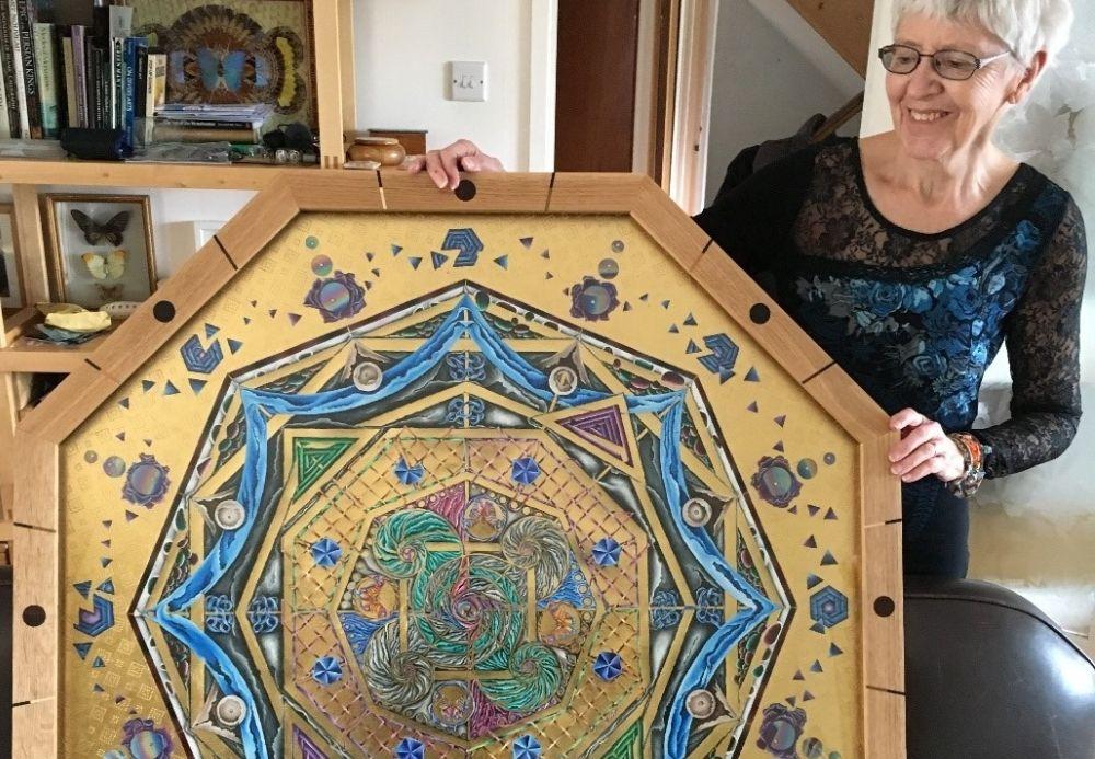 Artist holding artwork